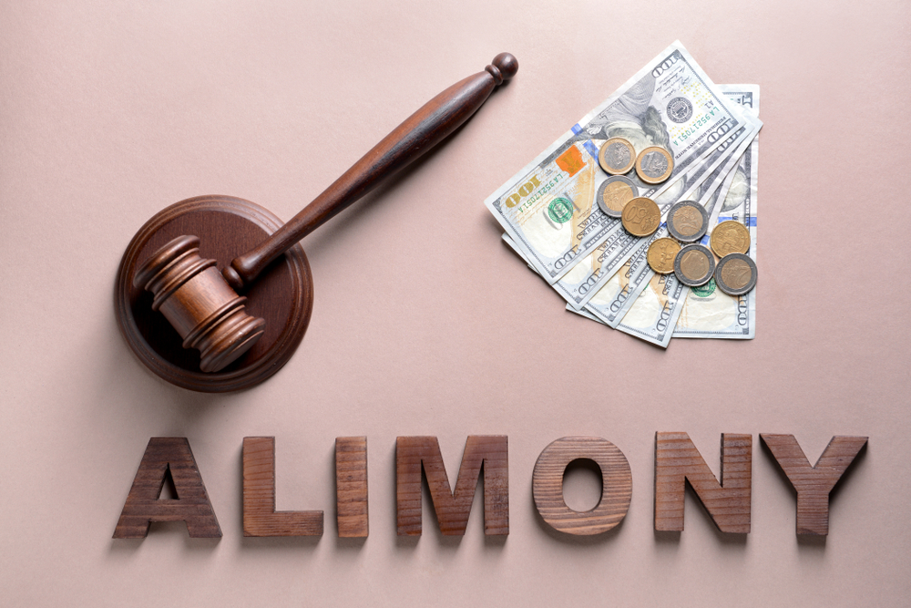 money on the table with alimony word